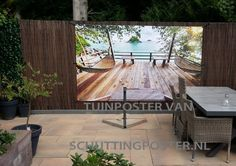 #tuin in een handomdraai veranderd met #tuinposter vlonderterras!