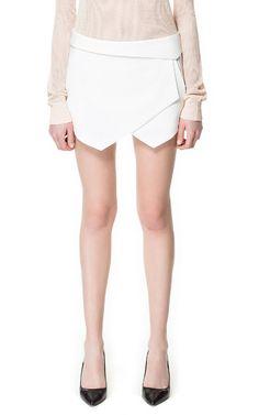 White mini skirt.