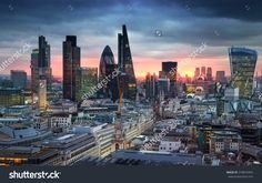 LONDON, UK - JANUARY 27, 2015: City of London, business and banking area. London's panorama in sun set. View from the St. Paul cathedral