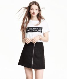 Short, A-line skirt with a front fastening.