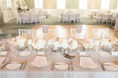 Tall crystal votive holders, and a pleasing mix of arrangements and candles create such a dreamy tablescape | Soft and Romantic Virginia Country Club Wedding | Regency at Dominion Valley | Jillian Michelle Photography