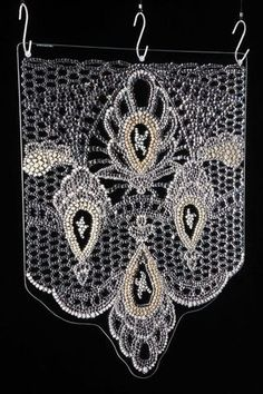 Picture of Lace By Joanna Manousis Material: Water-jet cut / Fused Glass Dimensions: 61cm x 50cm x 1cm approx Year: 2008