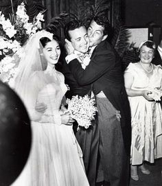 Vic Damone got a big old kiss from Dean Martin on his wedding day to actress Pier Angeli  -- Nov 24, 1954. These 2 had a huge wedding in Beverly Hills. I ate enough cake for a year at this one and 2 of the Martin kids took a bottle of champagne under one of the tables for us to start our own party with!