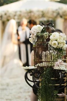 Nisie's Enchanted Florist - Wedding Florist Orange County...Love the idea of the birdcage on the table