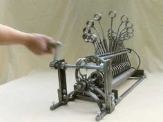 Hand powered kinetic sculpture by Joh Lash