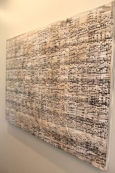 Sheet music art. Layering the transparencies to make a small copy of your image and then enlarge it to fit your wall space.