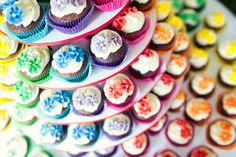 A rainbow-colored cupcake tower {Weddings by Hanel}