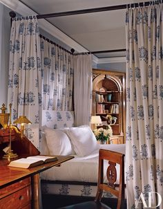 "In the guest room, Duffy chose an Indian fabric with an elephant motif for the four-poster, ""just for fun"" canopy bed metal"