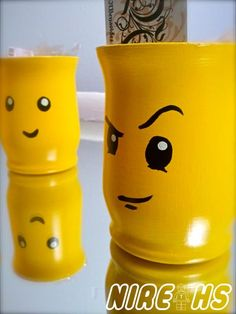 Lego centerpieces!  I'm sure these would be easy to make by spraypainting vases or candle holders yellow and making their little faces. :)