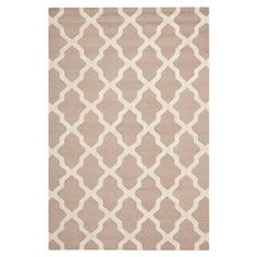 Hand-tufted wool rug with a geometric motif.   Product: RugConstruction Material: WoolColor: Beige and ivoryFeatures:  Made in IndiaHand-tufted Note: Please be aware that actual colors may vary from those shown on your screen. Accent rugs may also not show the entire pattern that the corresponding area rugs have.Cleaning and Care: Professional cleaning recommended