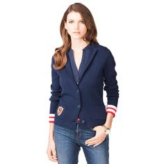 Nautical style highlight. Crafted from combed cotton, this blazer stands out with nautical stripes on the back panel and flipped cuffs. Collar with contrast tape along the neckline. Notched lapel and low-starting placket. Open patch pockets at the hips with Tommy Hilfiger logo crest embroidered on wearer's right, logo tag on the sleeve