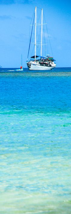 Shades of blue on the great Mackerel Beach, Australia.