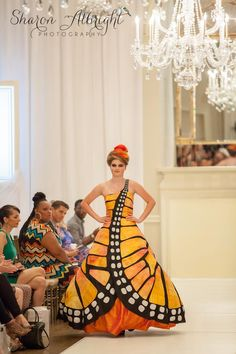 Monarch Butterfly Dress by Emily Kramer. Made from recycled textbooks for Charlotte Fashion Week's Recycled Design Competition. #savethemonarchs #butterfly #monarch #runway #fashion #fashionweek #dress #gown #recycled