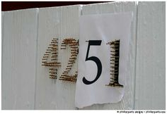 house numbers made of nails! must use this to replace my awful house numbers  found on stinkerpants.com