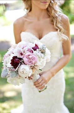Wedding bouquet. Mostly white, with accents of lavender and dark plum.