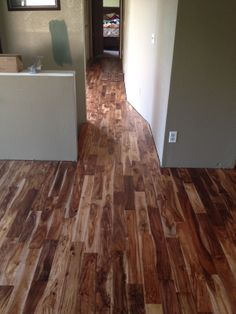 """The wood is just flat our gorgeous. If you want a uniform looking floor with the same dominant color and long planks, this isn't the floor for you. The wood has a ton of variations in color and grain. No 2 pieces look alike.""  {Builder's Pride- Tobacco Road Acacia}"