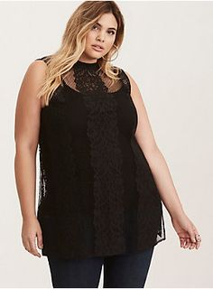 """We're taking bets that this is hands down the most unique top you'll ever own. The sheer black lace tank already has us planning our layering options, with a cool fishnet-type open stitch that's a cool rock 'n' roll contrast to the very elegant lace. A high mock neck lends class to the sassy style, side slits lend movement. See? Told you.<div><ul><li style=""""LIST-STYLE-POSITION: outside !important; LIST-STYLE-TYPE: disc !important"""">Size 1 me..."""