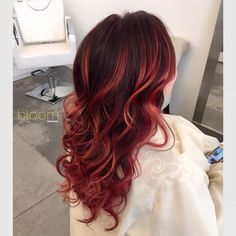 Copper balayage highlights on vivid red long hair. By bloom stylist Samantha