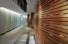 These undulating wooden walls were made from white oak planks--which together total over 3 miles in length. The walls hides a laser-cut steel support system. Architecture Design Concept, Studios Architecture, Feature Wall Design, Feature Walls, Decorative Screens, Layout, Architectural Features, Wood Slats, Inspiration Wall
