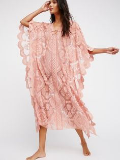 Mandala Mykonos Kaftan   Oversized crochet lace kaftan pieced with sheer mesh. * Plunging neckline with lace-up detailing. * Scalloped trim.