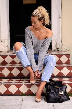 Grey knit oversize v-neck sweater with comfy ripped jeans