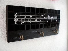 Chaveiro com notas musicais