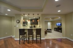 like the molding and color contrast in the ceiling to hide basement duct work.