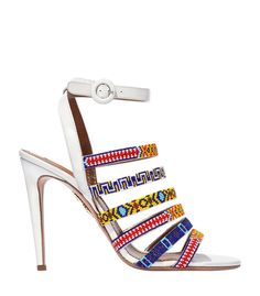 White sandal featuring multicolor beaded strap detail. ShopBazaar, shop designer clothing, shoes and accessories selected exclusively by the editors at Harper's Bazaar.