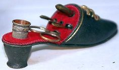 ANTIQUE-c.1890 SHOE-ETUI . MADE OUT OF METAL FOR A THIMBLE, AWL, SCISSORS, NEEDLE CASE AND MORE.