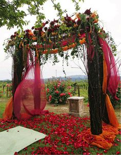 rustic wedding Arbors - this would be amazing on the beach less orange  more purple
