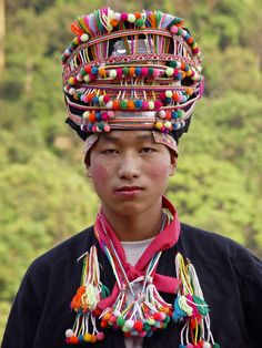 Akha man with traditional headdress.  Akha village in Luang Namtha province, Laos | ©  Kees Sprengers