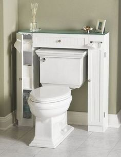 This surround toilet cabinet takes up less space than your regular cabinet and keeps everything organized in your bathroom. http://hative.com/clever-bathroom-storage-ideas/