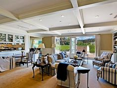 Pacific Palisades home family room with french doors out to a large, flat lawn!