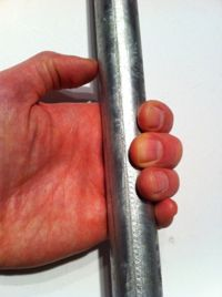 Good Pull-up grip. Would help a ton with ripping your hands open @ Crossfit
