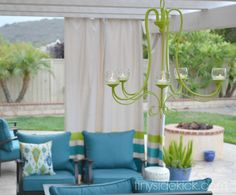 Patio make-over. Candelier up cycle from discarded chandelier. Outdoor curtains, too. :-)