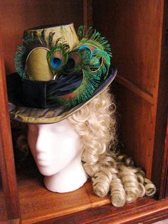 Late 1880s Victorian Women's Tall Riding Hat, Silk Taffeta with Peacock Cockade Love the peacock feathers