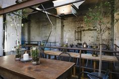 Distressed concrete walls and exposed structural beams overhead reinforce the industrial character of the space