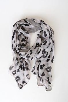 Let your free spirit roam in the Lulus Running Wild Grey Leopard Print Scarf! This chic scarf is shaped from lightweight woven fabric, in a trendy leopard print, and features a rectangular design, finished with a contrasting grey trim border. Faux Fur Stole, Leopard Print Scarf, Spell Designs, Grey Trim, White Leopard, Oversized Scarf, Retro Outfits, Womens Scarves, Grey And White