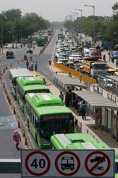 A view of the Bus Rapid Transit (BRT) system in New Delhi when it first opened in April Rapid Transit, Bus Terminal, Road Construction, Urban Setting, Bus Station, Mode Of Transport, Bus Stop, Wall Street Journal, Urban Planning