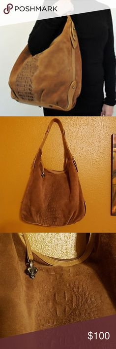 "Donald J. Pliner Suede Hobo Bag Gorgeous light brown suede with embossed alligator pattern on the sides.  Leather trim and bottom.  Brass rivets.  Fleur de lis medallion on zipper pull.  One inside zip pocket and 3 open inside pockets (one is made of leather).  Made in the mountains of Italy. 18"" wide and 14"" tall.  This purse is in excellent condition.  The only flaw is some minor staining on the pleated part of the leather near the bottom (See last picture) but it is hardly noticeable when…"