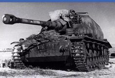 """A destroyed """"Dicker Max"""" being examined by a Russian soldier. One of two produced & used by German Army Group South."""