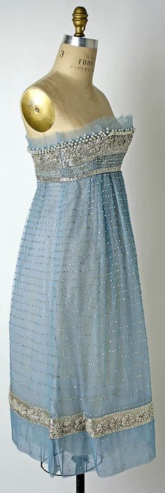 Christian Dior Couture Evening dress by designer Yves Saint Laurent fall/winter 1958-1959 made from blue nylon tulle, rhinestones and simulated pearl bead. Beaded and embroidered.  House of Dior.
