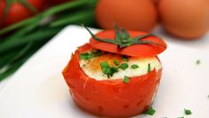 Baked eggs in roasted tomatoes recipe