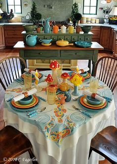 Go back & visit this site-tons of tablescapes & I love her kitchen!