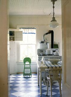 Vintage country kitchen. Love the pendant light and checkered floor!