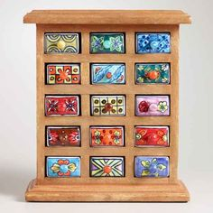 This cute ceramic wooden chest of drawers to store your jewelry in.