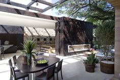 indoor and outdoor living, brazil ~ This unique loft by São Paulo-based Fernanda Marques was designed to create easy links between the outside and the inside areas of the home. Using Limestone, steel, glass and rough stone each area was designed with a strong modernist feel creating a unique environment that is seamless and completely beautiful