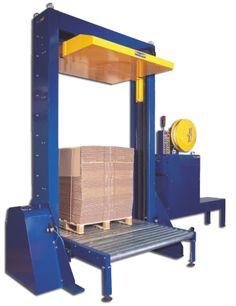 2210. Prensa Flejadora Automática vertical con cabezal superior. Máquina automática con prensa para el flejado vertical de palets de cartón. Reducción efectiva del volumen del palet para mejorar el transporte y almacenaje.