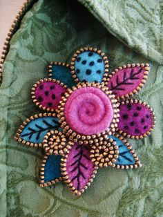 Zippers and Felt.  Leaves and a rose... by woolly  fabulous, via Flickr,  just beautiful colors !
