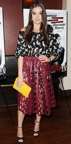 Hailee Steinfeld in a black-and-white printed off-shoulder mini with a maroon perforated leather midi.